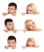 Collage on six photos - Young teenage girl and boy hiding behind a billboard — Stock Photo