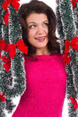 Woman with tinsel — Stock Photo