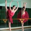 Beautiful dancer ballerina is doing exercises in ballet class — Стоковая фотография