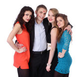 Young man with three girls and lipstick kiss-marks — Stock Photo