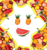 Frame of human face with assortment of various fruits — Stock Photo