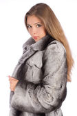 Woman in a fur coat — Stock Photo