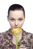 Woman sniff a yellow tulip — Stock Photo