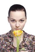 Woman sniff a yellow tulip — Stock Photo