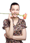 Attractive young woman with a yellow tulip — Stock Photo