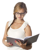 Young girl with glasses reading — Stock Photo