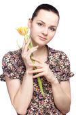Young beautiful woman with yellow tulip — Stock Photo