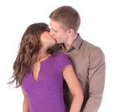 Loving couple kissing isolated on white background — Stock Photo