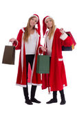 Two twins holding shopping bags — Stock Photo