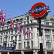 London Underground and Union Flags - Stock Photo