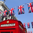 Telephone Box and Union Flags in London — Stock Photo #12958716
