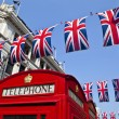 Stock Photo: Telephone Box and Union Flags in London