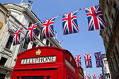 Telephone Box and Union Flags in London — Stock Photo