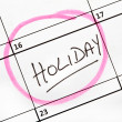 Stock Photo: Holiday Date Marked on Calendar.