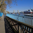 Thames Path leading to Tower Bridge - Stock Photo