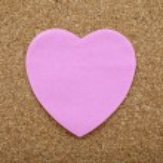 A Heart Sticky Label on a Notice Board — Stock Photo