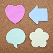 Stock Photo: Four Different Sticky Notes on a Notice Board