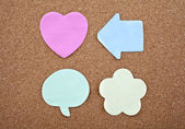 Four Different Sticky Notes on a Notice Board — Stock Photo