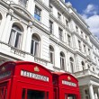 Red Telephone Boxes outside Attractive London Appartments — Stock Photo #26810141
