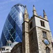 St Andrew Undershaft Church and the Gherkin in London — Stock Photo #48197897