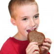 Happy Boy Biting Chocolate Heart — Stock Photo