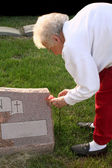 Senior Woman Visiting Grave — Stock Photo