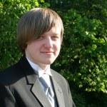 Smiling Teen Boy In Black Tuxedo Horizontal — Stock Photo #44962567