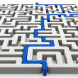 Solved maze with blue arrow — Stock Photo #15131253