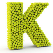 3D letter K made from tennis balls — Stock Photo