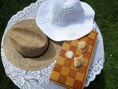 Sombreros de ajedrez y veranos — Foto de Stock