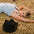 Girl resting on hay - Stock Photo
