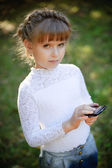 Girl with a smartphone — Stock Photo