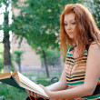 Stock Photo: Girl reading