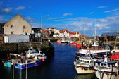 Fishing boats within the harbour walls. — Stock Photo