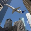 Downtown Buildings & Jet Air Plane — Stock Photo #6945982