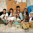 Stock Photo: Men and boys chewing street qat khat sanacity yemen
