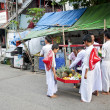Burmese buddhist novices collecting offerings yangon myanmar - Stock Photo
