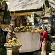 Stock Photo: Woman at temple in bali indonesia