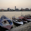 Nile riverside with boats in cairo egypt - Stok fotoğraf