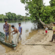 Young men fishing in rural cambodia - Stockfoto