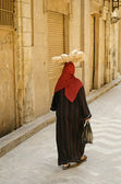 Street scene with veiled woman in cairo old town egypt — Stock Photo