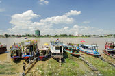 Tourist boats on tonle sap river in cambodia — Stock Photo