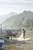 Fishermen working on beach in dili east timor — Stock Photo