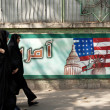 Stock Photo: Anti americmural in tehrirwith veiled women