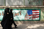 Anti american mural in tehran iran with veiled women — Stock Photo