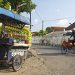 Stock Photo: Petrol stall and cyclo taxi in solo city indonesia