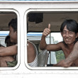 Man smiling on yangon myanmar bus — Stock Photo
