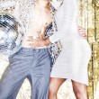 70s disco style couple posing with mirror ball — Stock Photo #49433511