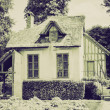 Vintage sepia Old cottage — Stock Photo