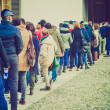 Retro look People queueing — Stock Photo #40006801